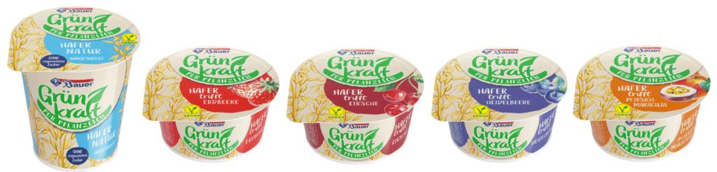 Produktfotos der veganen Produkte von Grünkraft: Pflanzliche Joghurtalternativen in den fünf Geschmacksrichtungen Pur, Heidelbeere, Pfirsich-Maracuja, Krische und Erdbeere